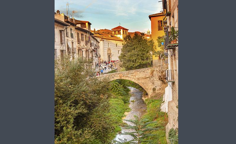 Paseo de los Tristes in Granada, next to the river Darro